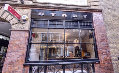 London designer store bridges bricks and clicks